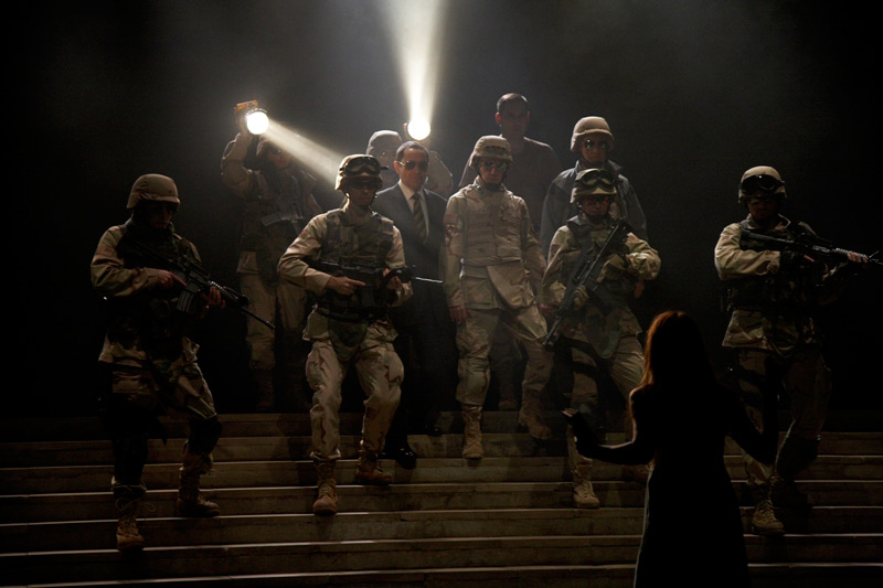 The cast of STC's The Art of War, 2007, surround Brandon Burke.  Photo: Tania Kelly ©
